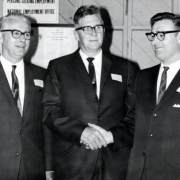 Who are the men in this photo? What year is it?